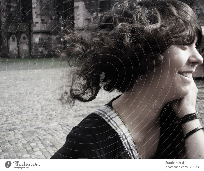 a smile from her... Exterior shot Day Shadow Sunlight Motion blur Central perspective Looking away Joy Hair and hairstyles Skin Human being Feminine Young woman