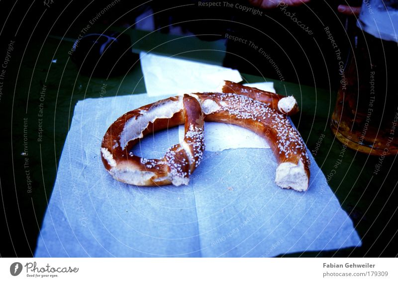 pretzel Food Dough Baked goods Going out Drinking Fairs & Carnivals Beer garden Blue Brown Pretzel Colour photo Subdued colour Exterior shot Day Shadow Contrast