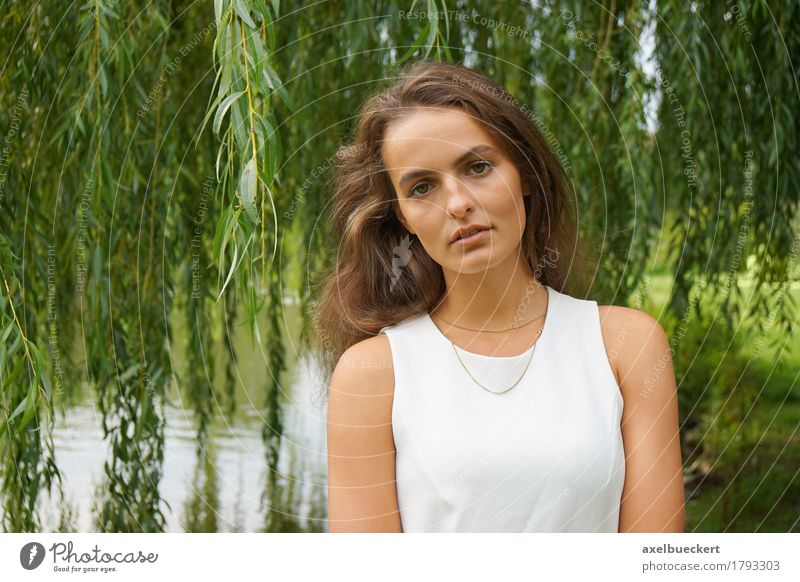 young woman wearing white dress in a park Human being Woman Nature Youth (Young adults) Beautiful Young woman White Tree 18 - 30 years Adults Lifestyle Feminine Garden Lake Park Leisure and hobbies