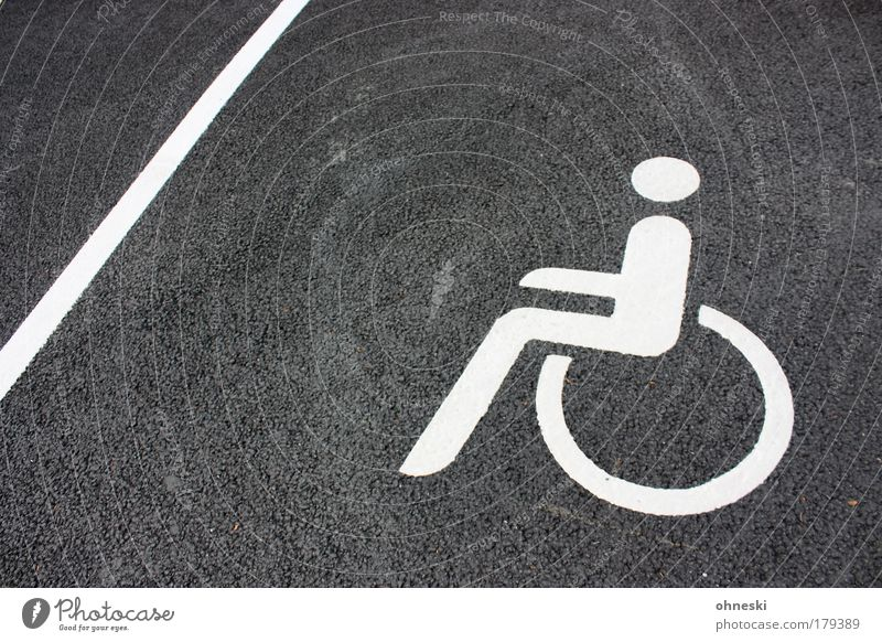 Human being Sit Signs and labeling Concrete Masculine Driving Pain Barrier Parking lot Handicapped Wheelchair Road sign Limitation