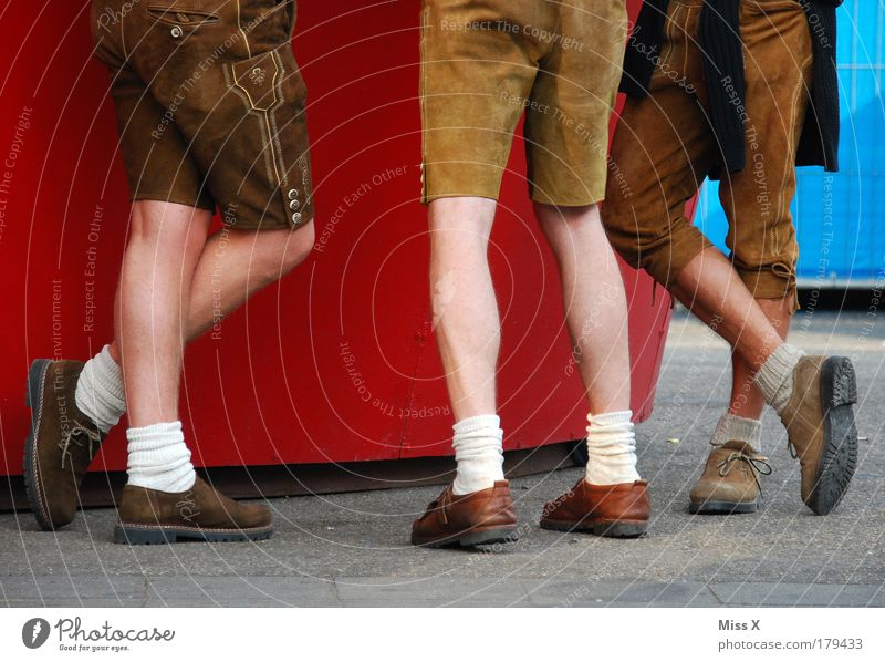 Human being Group Legs Feet Funny Friendship Feasts & Celebrations Happiness Masculine Drinking Munich Fairs & Carnivals Event Bavaria Tradition Oktoberfest