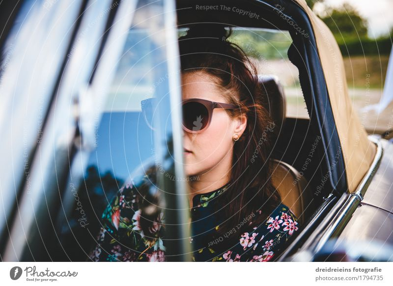 Retro girl. Lifestyle Style Feminine Young woman Youth (Young adults) Motoring Vehicle Car Vintage car Sports car Sunglasses Brunette Driving Looking Sit
