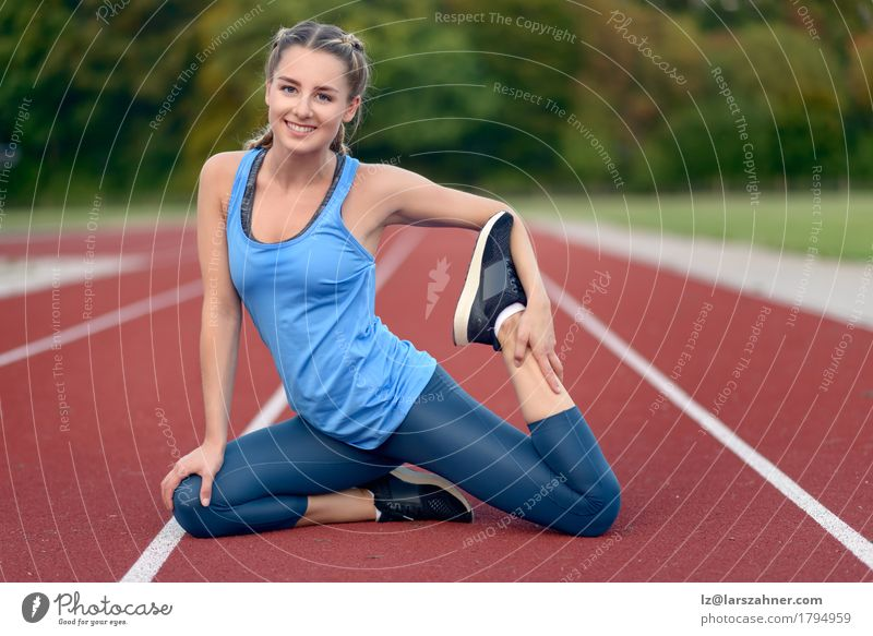 Happy fit young woman doing stretching exercises Human being Woman Youth (Young adults) Summer Beautiful 18 - 30 years Face Adults Lifestyle Sports Feminine Happy Copy Space Blonde Action Smiling