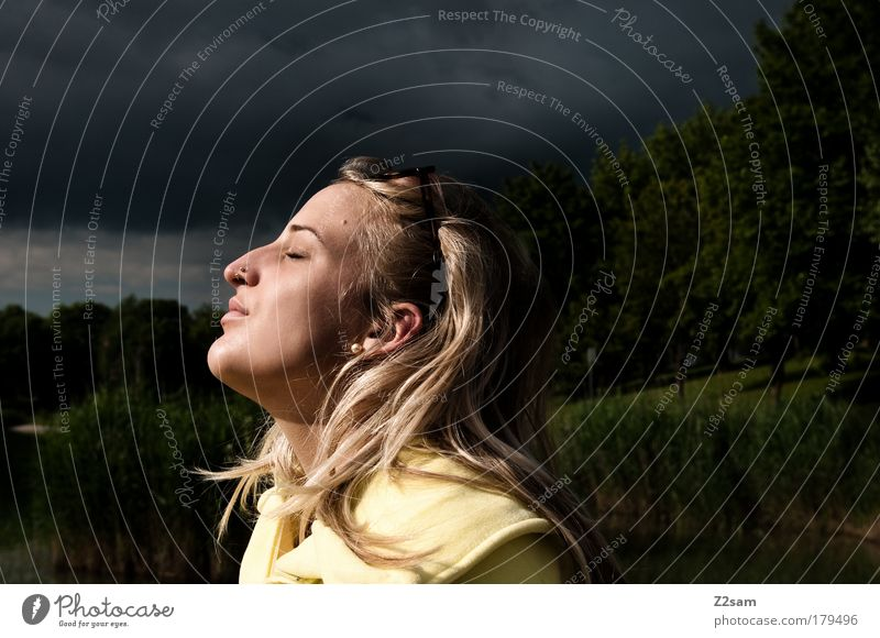 epicure Colour photo Exterior shot Sunbeam Deep depth of field Closed eyes Hunting Human being Feminine Head Hair and hairstyles Nature Landscape Storm clouds