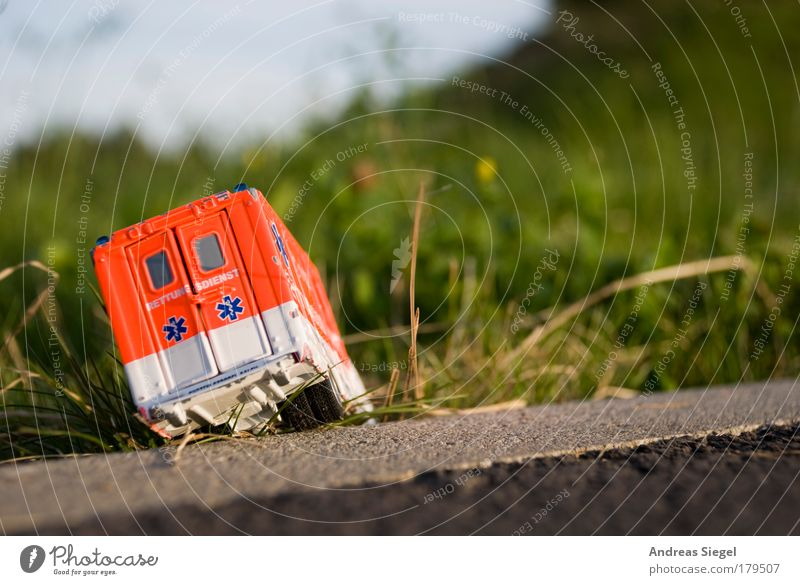 rescuer in distress Colour photo Exterior shot Deserted Day Sunlight Blur Leisure and hobbies Playing Model-making Toys Toy car Garden Meadow Traffic accident