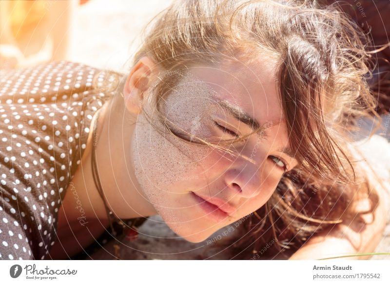 Young woman lies on the beach with sand in her face Lifestyle Joy Sand already Face Relaxation Calm Vacation & Travel Tourism Summer vacation Beach Human being