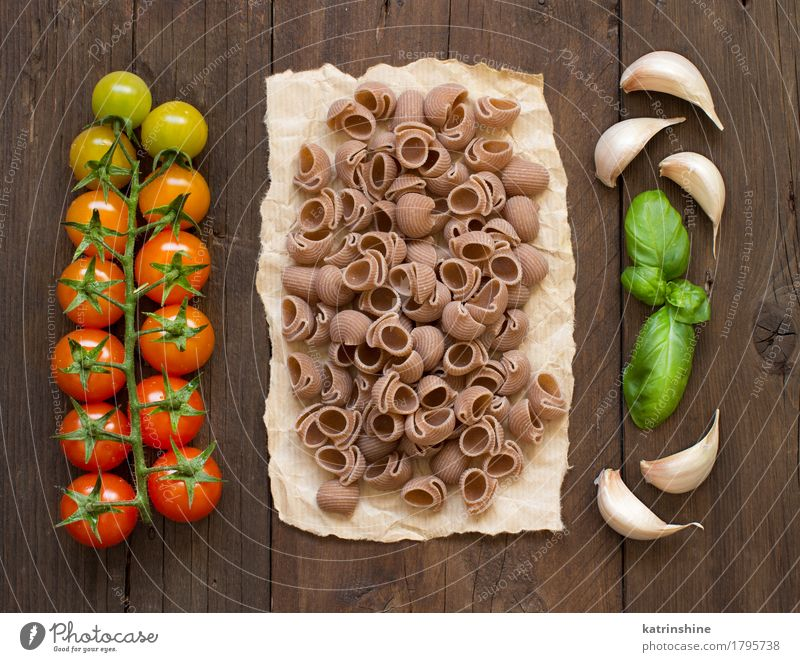 Raw conchiglie pasta, basil and vegetables Green Red Healthy Brown Fresh Herbs and spices Vegetable Baked goods Meal Vegetarian diet Diet Tomato Dough