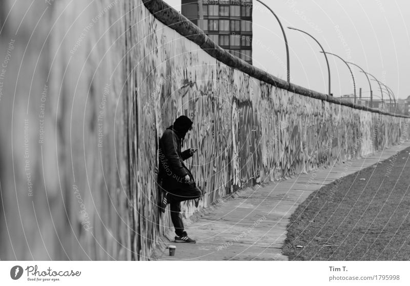autumn Berlin Wall (barrier) Wall (building) Stagnating Border The Wall Cellphone Telephone Black & white photo Graffiti Exterior shot Day