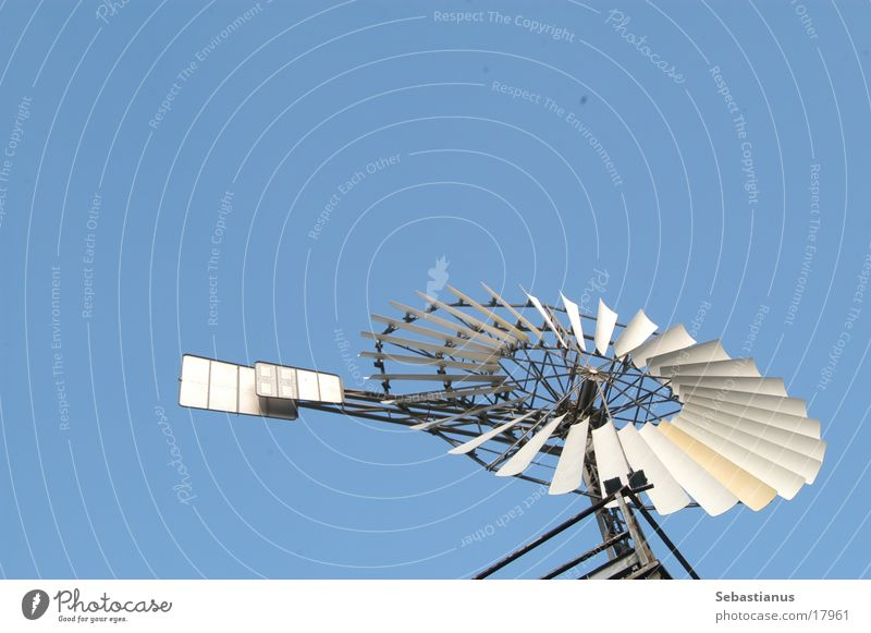 Windmill in the sky Sky Pinwheel Isolated Image Object photography Copy Space top Bright background Bucket wheel Movement Rotate Rotation Circular Thorough