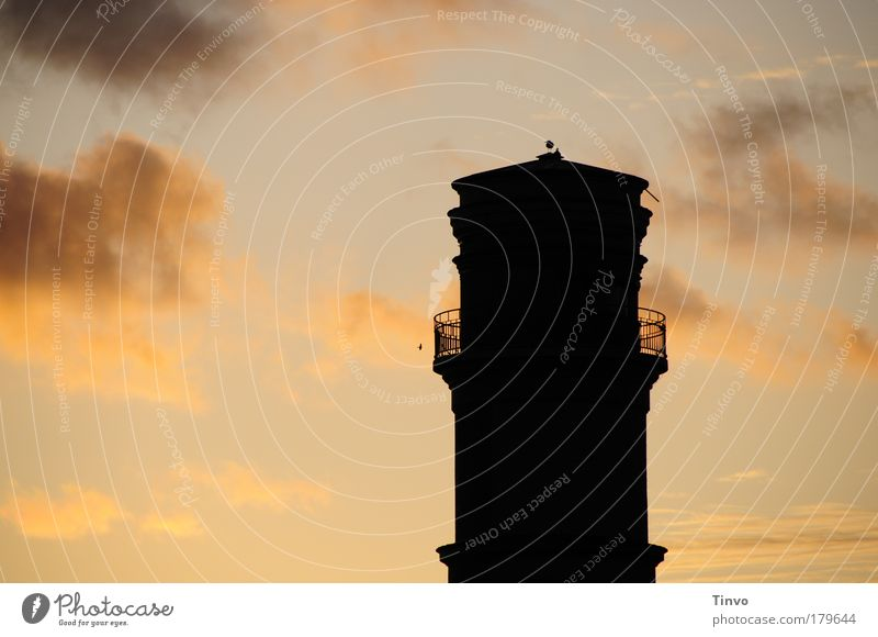 Old Lighthouse Colour photo Exterior shot Deserted Copy Space left Evening Twilight Contrast Silhouette Sunrise Sunset Sky Clouds Navigation Dark Large Round