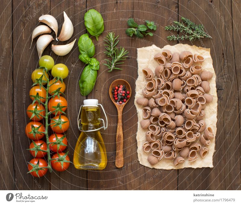 Whole spelt pasta, vegetables, herbs and olive oil Green Red Dark Brown Fresh Italy Herbs and spices Vegetable Baked goods Bottle Vegetarian diet Diet Tomato