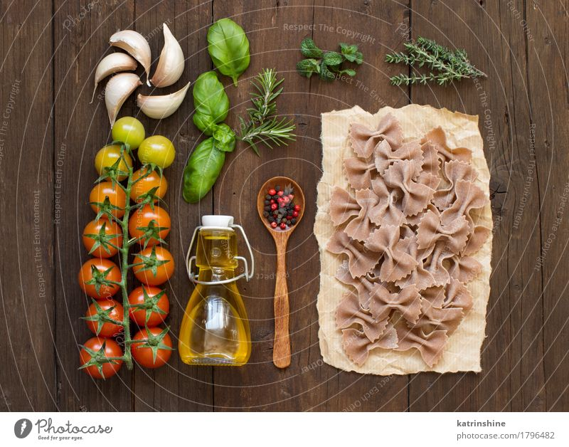 Whole wheat pasta, vegetables, herbs and olive oil Green Red Dark Brown Fresh Italy Herbs and spices Vegetable Baked goods Bottle Meal Vegetarian diet Diet