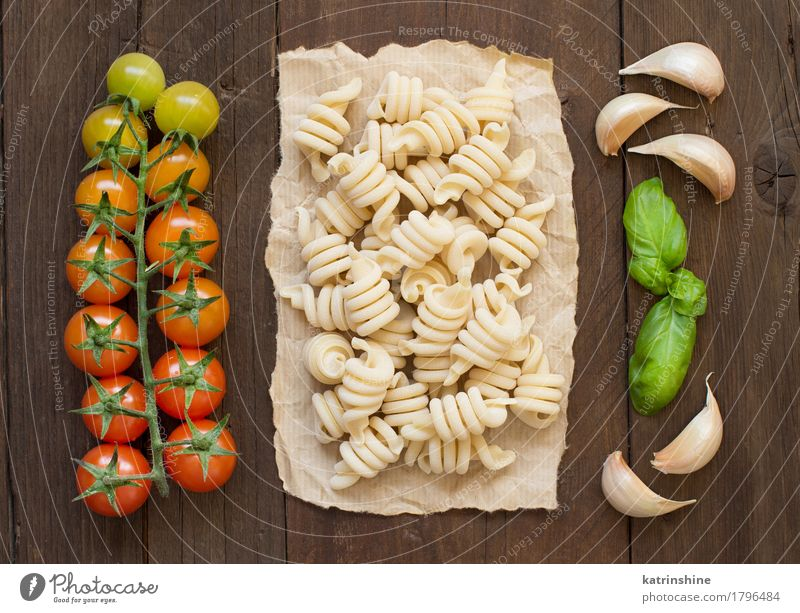 Raw italian pasta, basil and vegetables Green Red Dark Healthy Brown Fresh Herbs and spices Vegetable Baked goods Meal Vegetarian diet Diet Tomato Dough