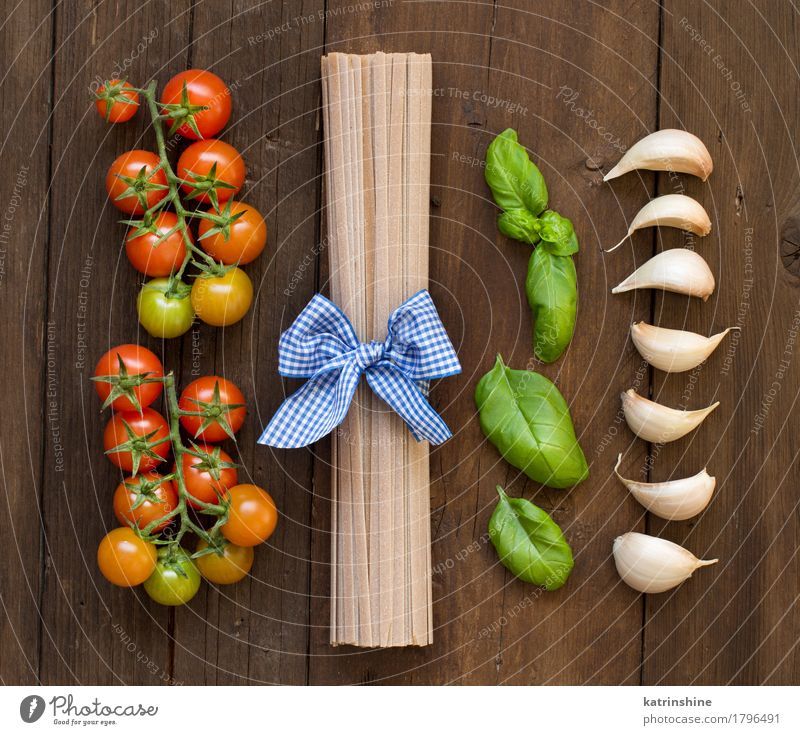 Raw fettucce pasta, basil and vegetables Green Red Dark Brown Fresh Herbs and spices Vegetable Tradition Baked goods Meal Vegetarian diet Diet Tomato Dough
