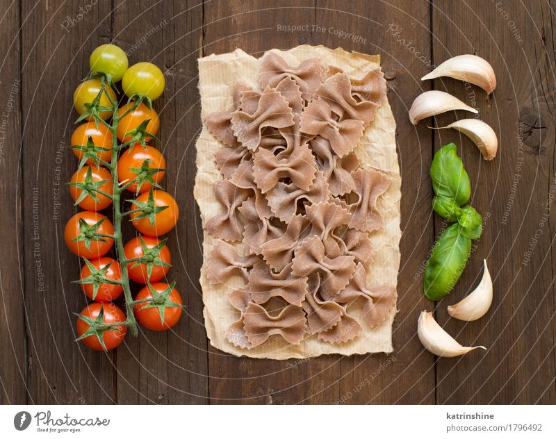 Raw farfalle pasta, basil and vegetables Green Red Dark Brown Fresh Herbs and spices Vegetable Tradition Baked goods Meal Vegetarian diet Diet Tomato Dough