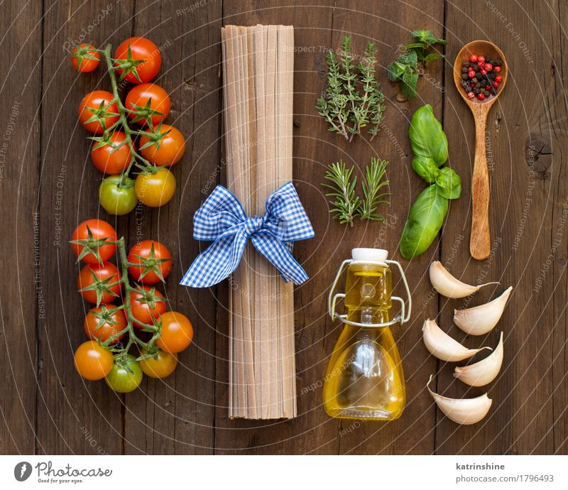 Raw fettuccine pasta, vegetables, herbs and olive oil Green Red Dark Healthy Brown Fresh Herbs and spices Vegetable Tradition Baked goods Bottle Meal