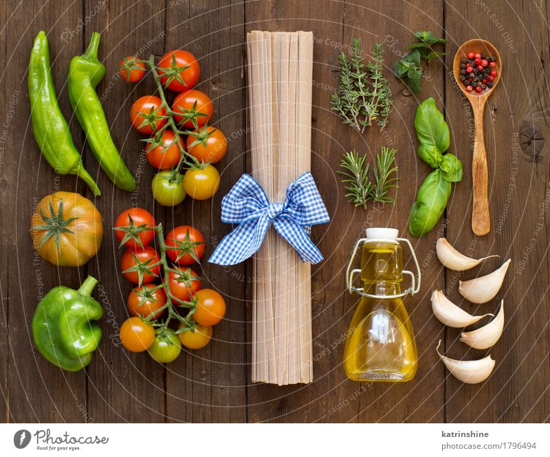 Raw spaghetti pasta, herbs, olive oil and vegetables Green Red Dark Brown Fresh Herbs and spices Vegetable Tradition Baked goods Bottle Meal Vegetarian diet