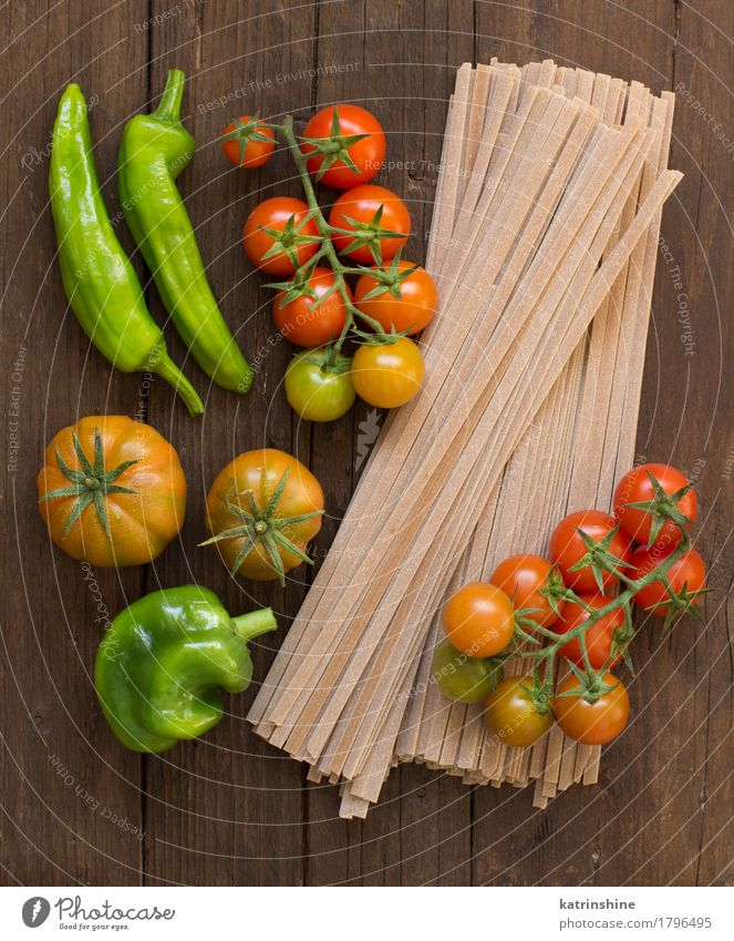 Raw fettuccine pasta and vegetables Green Red Dark Healthy Brown Fresh Vegetable Tradition Baked goods Meal Vegetarian diet Diet Tomato Dough Ingredients