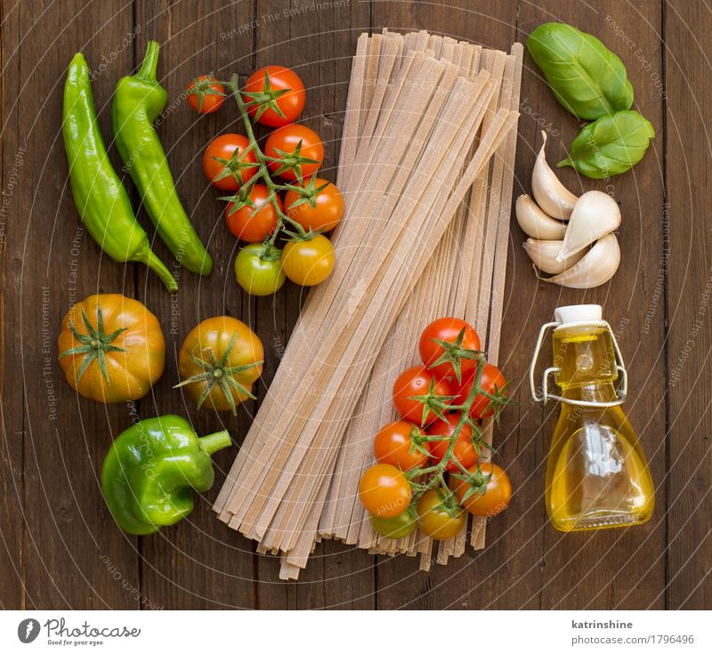 Raw fettucce pasta, vegetables and olive oil Green Red Dark Brown Fresh Herbs and spices Vegetable Tradition Baked goods Bottle Meal Vegetarian diet Diet Tomato
