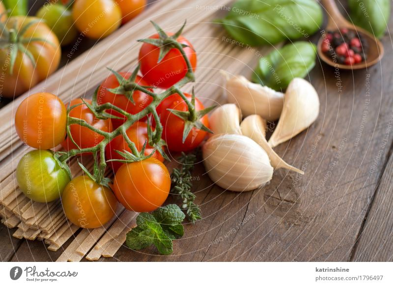 Raw fettuccine pasta, vegetables and herbs Green Red Dark Healthy Brown Fresh Herbs and spices Vegetable Tradition Baked goods Meal Vegetarian diet Diet Tomato