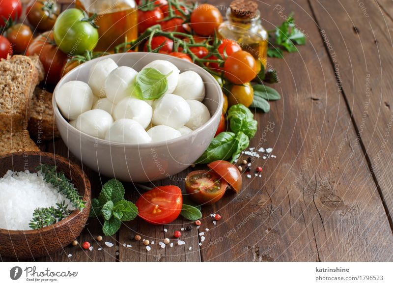 Italian food ingredients for caprese salad Green Red Natural Healthy Brown Bright Fresh Herbs and spices Vegetable Bread Bowl Bottle Meal Vegetarian diet Diet