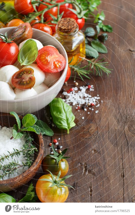 Italian ingridients for caprese salad Green Red Natural Healthy Brown Bright Fresh Herbs and spices Vegetable Bowl Bottle Meal Vegetarian diet Diet Salad Tomato