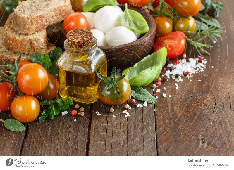 Italian cooking ingridients Green Red Natural Healthy Brown Bright Fresh Herbs and spices Vegetable Bread Bowl Bottle Meal Vegetarian diet Diet Salad