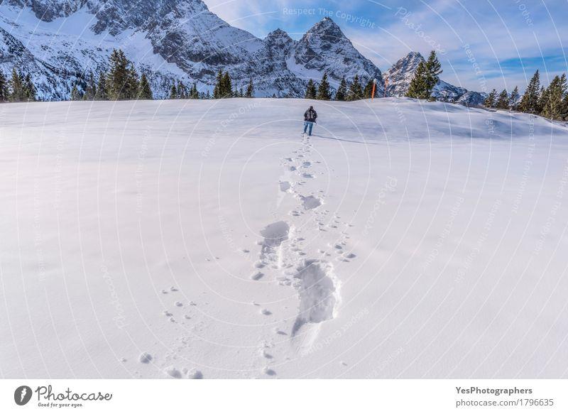 Man walking through snow on a mountain peak Human being Nature Blue White Landscape Winter Mountain Adults Snow Tourism Europe Frost Seasons Alps