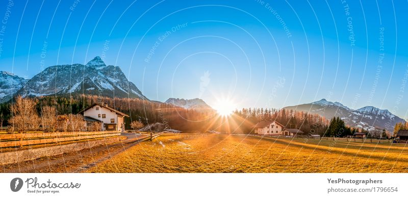 Alpine village under sun rays Nature Vacation & Travel Blue Colour Beautiful Sun Landscape House (Residential Structure) Winter Forest Mountain Meadow Tourism