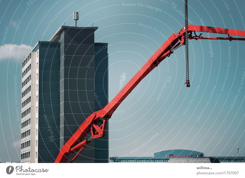 legal position Construction site housing Chemnitz High-rise Manmade structures Building Architecture Crane crane arm Chain Blue Red Emphasis Hydraulics
