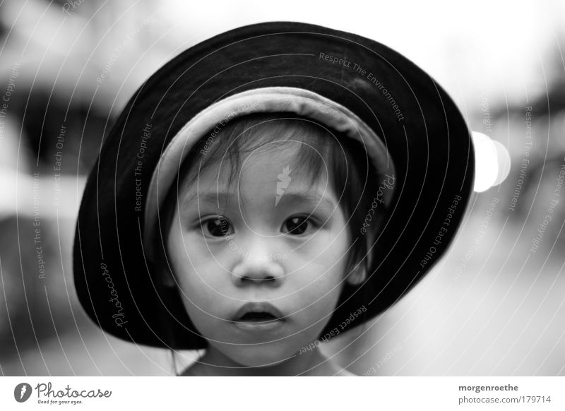 children of this world Black & white photo Exterior shot Day Contrast Shallow depth of field Portrait photograph Looking into the camera Skin Face Human being
