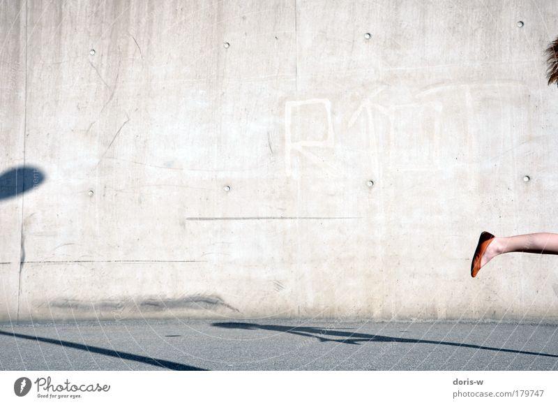 Woman Beautiful Summer Joy Adults Street Feminine Wall (building) Gray Movement Hair and hairstyles Jump Legs Feet Orange Footwear