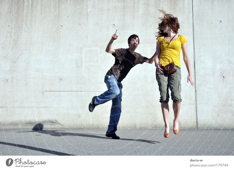 Human being Youth (Young adults) Summer Joy Man Love Street Feminine Wall (building) Woman Movement Happy Jump Couple Friendship Leisure and hobbies