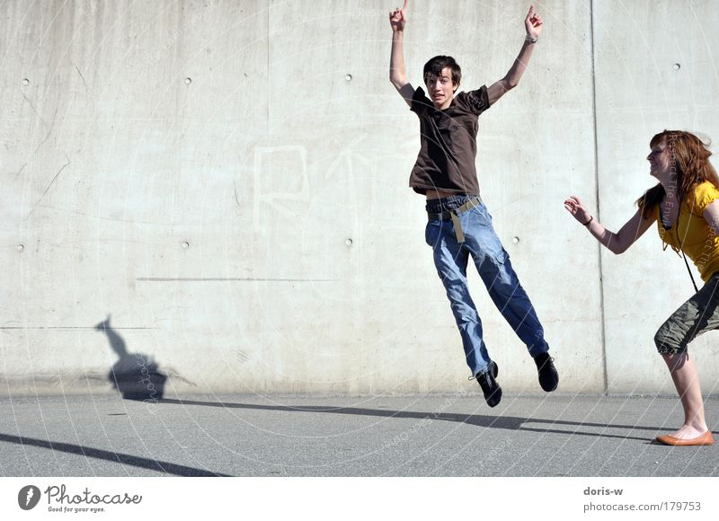 Youth (Young adults) Joy Human being Street Woman Wall (building) Movement Laughter Happy Jump Man Couple Friendship Background picture Walking Masculine