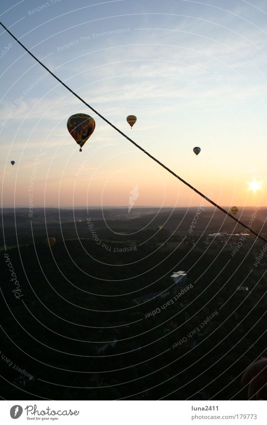 balloon ride Colour photo Exterior shot Dawn Sunrise Sunset Back-light Panorama (View) Landscape Sky Beautiful weather Field Small Town Hot Air Balloon Driving