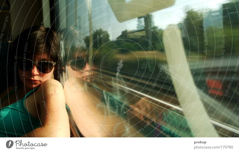 S-Bahn customer Colour photo Human being Feminine Young woman Youth (Young adults) Woman Adults Driving Passenger Railroad Commuter trains Vacation & Travel