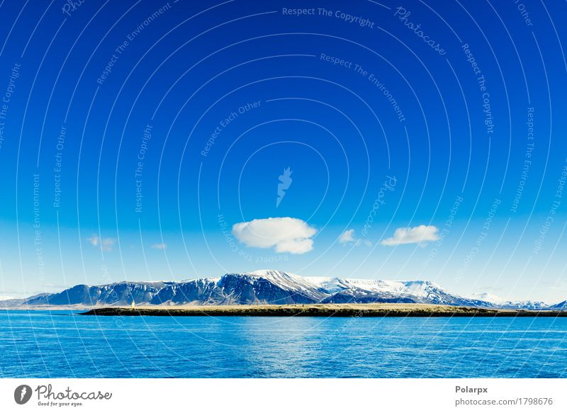Mountains in the blue ocean Beautiful Vacation & Travel Ocean Winter Snow Environment Nature Landscape Sky Clouds Horizon Climate Rock Coast Lake Freeze