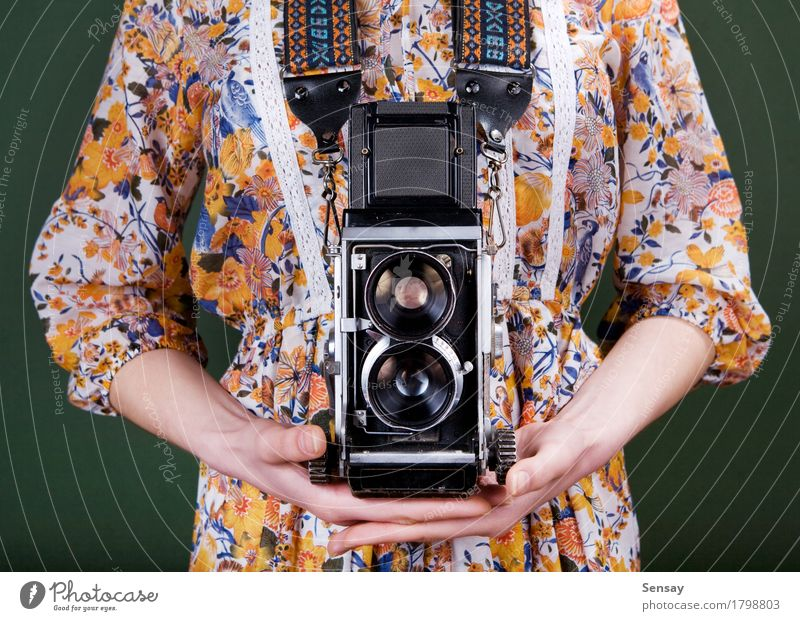 Vintage camera in hand on green Style Beautiful Camera Human being Girl Woman Adults Hand Flower Fashion Dress Old Retro Green Red White Colour vintage