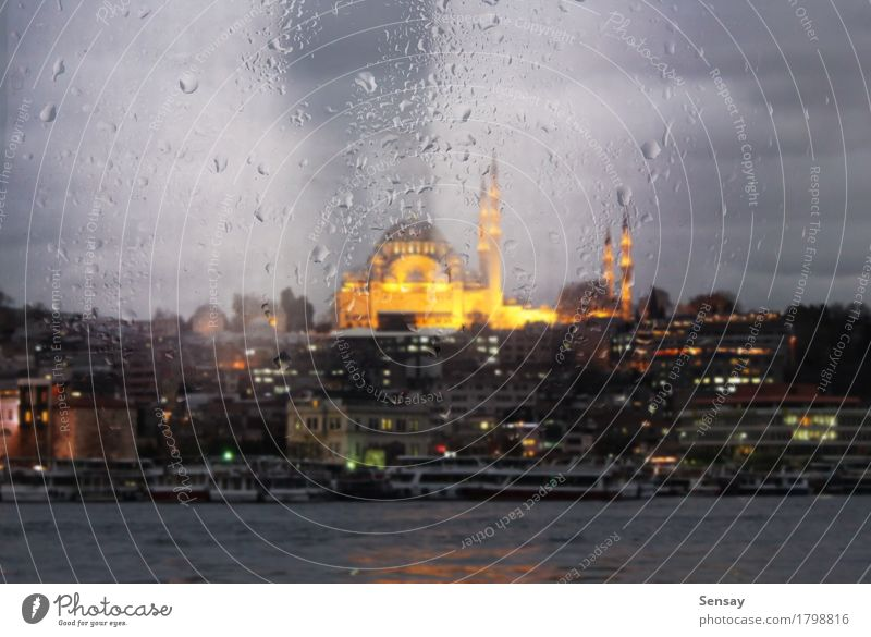 view of the mosque with evening lights through the window Ocean Landscape Rain Town Building Ferry Watercraft Drop Yellow Islam the religion East Asia turkey