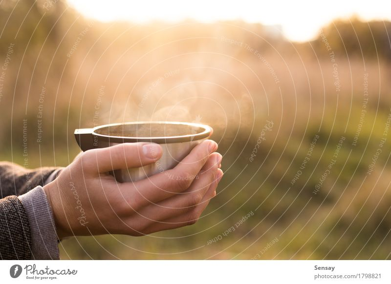 Thermos cup in hand on autumn background Coffee Tea Joy Sun Human being Woman Adults Hand Nature Autumn Street Hot thermos flask vacuum Seasons drink cold young