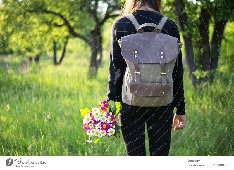 Woman hiking with backpack and flowers in hand Happy Beautiful Trip Summer Sun Hiking School Human being Girl Adults Youth (Young adults) Nature Flower Park