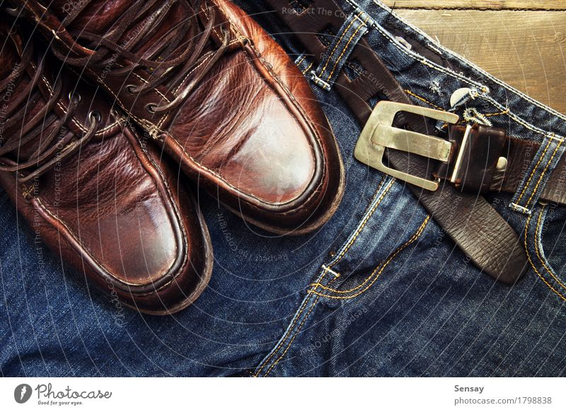 Jeans belt and shoes set on wooden board Style Vacation & Travel Man Adults Fashion Clothing Leather Footwear Boots Old Retro Blue Brown Black Denim