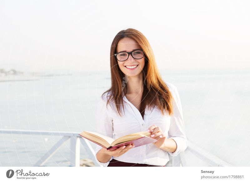 Young female student in reading glasses Happy Beautiful Face Relaxation Reading Summer Beach Ocean Business Human being Girl Woman Adults Street Fashion Smiling