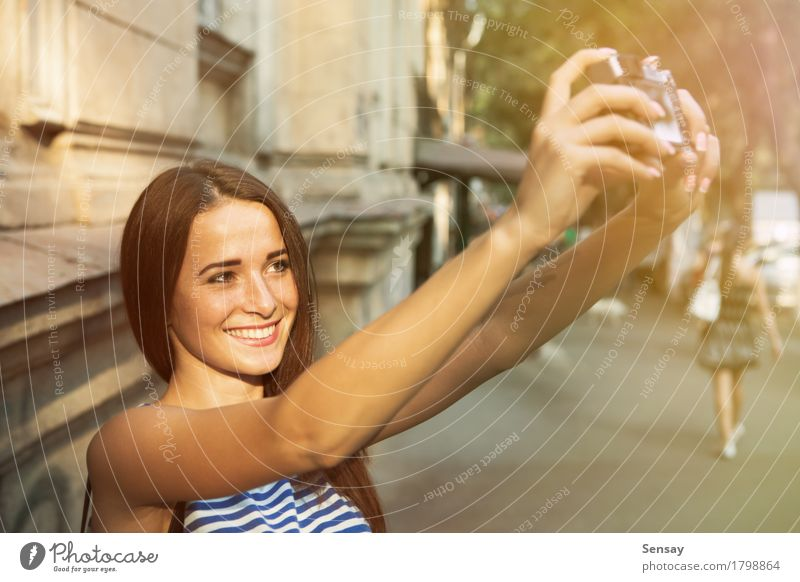 Pretty girl taking selfie on street Joy Happy Beautiful Face Vacation & Travel Summer Sun Camera Human being Girl Woman Adults Hand Autumn Street Fashion Hair