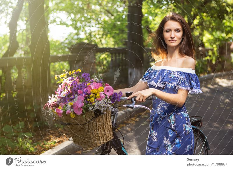 Girl with a bicycle and a basket of flowers Human being Woman Sky Nature Vacation & Travel Old Summer Green Beautiful Sun Tree Flower Landscape Adults Street