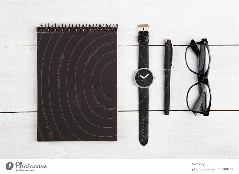 Notepad, watches, pen and glasses on the desk Vacation & Travel Man Old White Black Adults Wood Business Design Tourism Work and employment Office Clock Modern