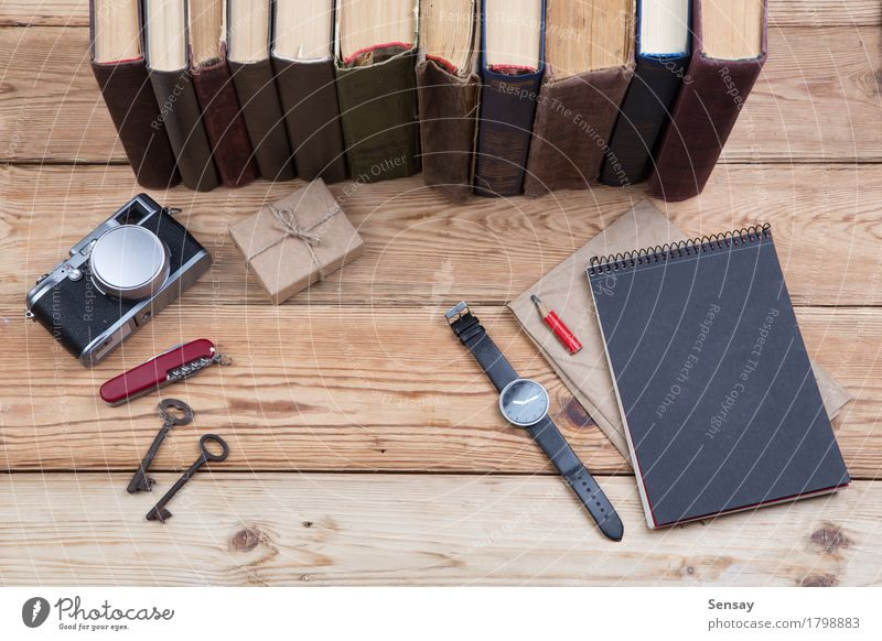 wooden desktop with books, camera, watch and gift box Lifestyle Wood Business School Design Work and employment Copy Space Office Trip Vantage point Table Book Photography Gift Observe Paper