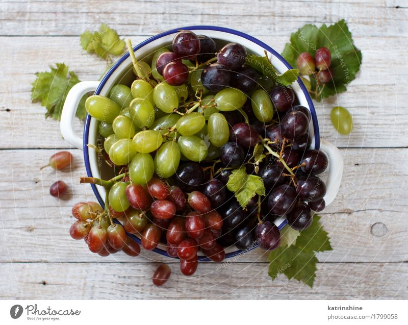 White, red and blue grapes in a bowl Fruit Nutrition Bowl Table Dark Fresh Retro Gray Green Red Agriculture Berries Food Bunch of grapes Grape vine Grapevine