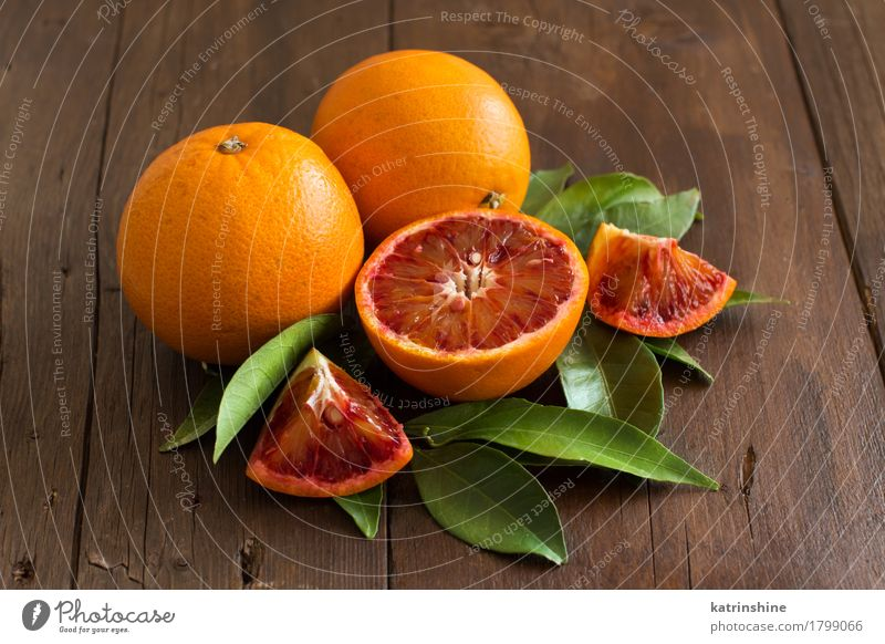 Fresh Sicilian oranges with leaves Fruit Orange Vegetarian diet Diet Exotic Garden Leaf Healthy Bright Juicy Brown Yellow Green agriculture citrus Cut cutting