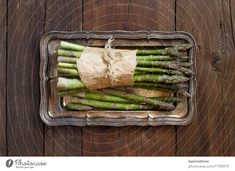 Bundle of fresh asparagus spears Vegetable Nutrition Dinner Vegetarian diet Diet Table Metal Dark Fresh Healthy Natural Brown Green Asparagus food Gourmet wood